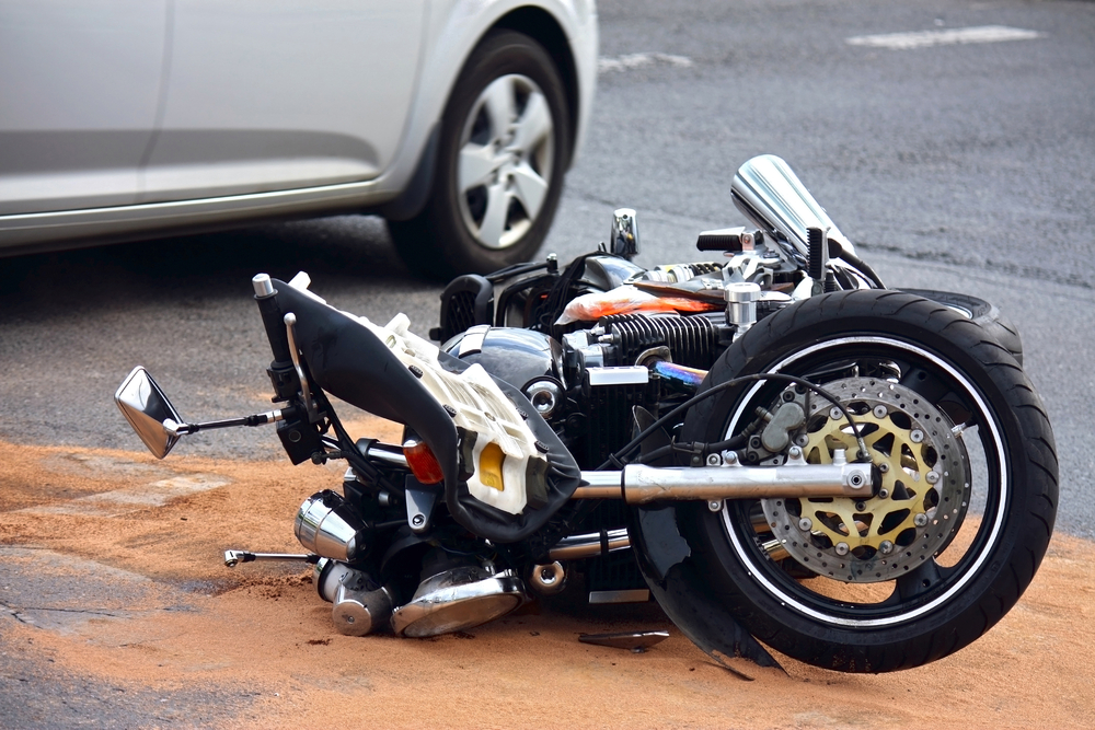 Motorcycle wreck after an auto accident